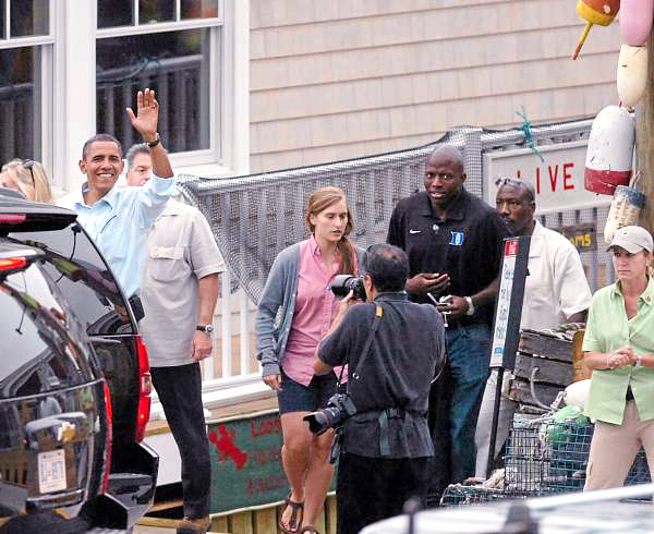 President Obama waves to crowds after dining at Steward's Downtown restaurant with his family during their vacation on Friday, July 16, 2010.  BANGOR DAILY NEWS PHOTO BY BRIDGET BROWN