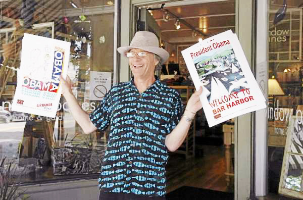 Russell D'Alessio shows freshly-made signs he designed to display in downtown Bar Harbor businesses for the president's visit outside of Window Panes on Friday morning, July 16, 2010. BANGOR DAILY NEWS PHOTO BY BRIDGET BROWN