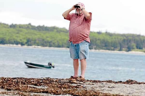 Wayne Stoddard of Rutland, Mass. watches for the first family to arrive at the Trenton Airport from Hadley Point on Mount Desert Island on Friday morning, July 16, 2010.  BANGOR DAILY NEWS PHOTO BY BRIDGET BROWN