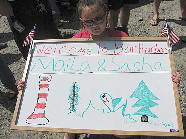 Tiffany Keating, 8, of Ellsworth, Maine, made a sign to welcome