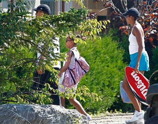President Barack Obama, left, daughter Sasha Obama and first lady Michelle Obama arrive at the Bar Harbor Club as they continue their weekend vacation in Bar Harbor, Maine, Saturday, July 17, 2010. (AP Photo/Charles Dharapak)