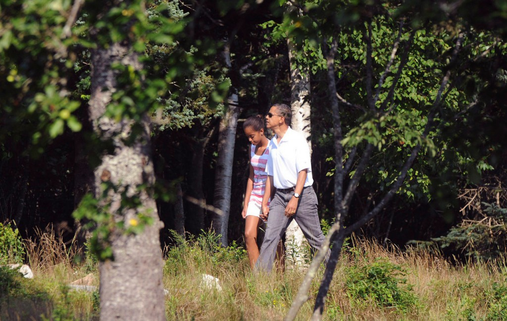 President Barack Obama walks with his older daughter, Malia,12, on the Ship Harbor hiking trail in Acadia National Park Saturday afternoon, July 17, 2010. (Bangor Daily News/Gabor Degre)
