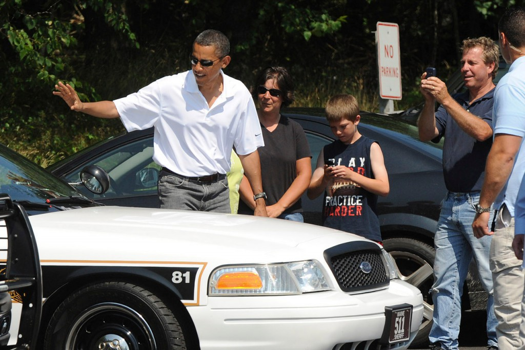 President Barack Obama waves to a Hancock County sheriff's seputy while visiting Bass Harbor Head Light Saturday afternoon, July 17, 2010. (Bangor Daily News/Gabor Degre)