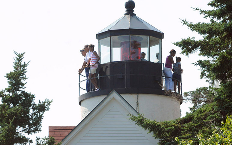 The first family visits the Bass Harbor Head Light with Coast Guard Station Chief Tim Chase in Bass Harbor, Saturday afternoon, July 17, 2010. (Bangor Daily News/Gabor Degre)