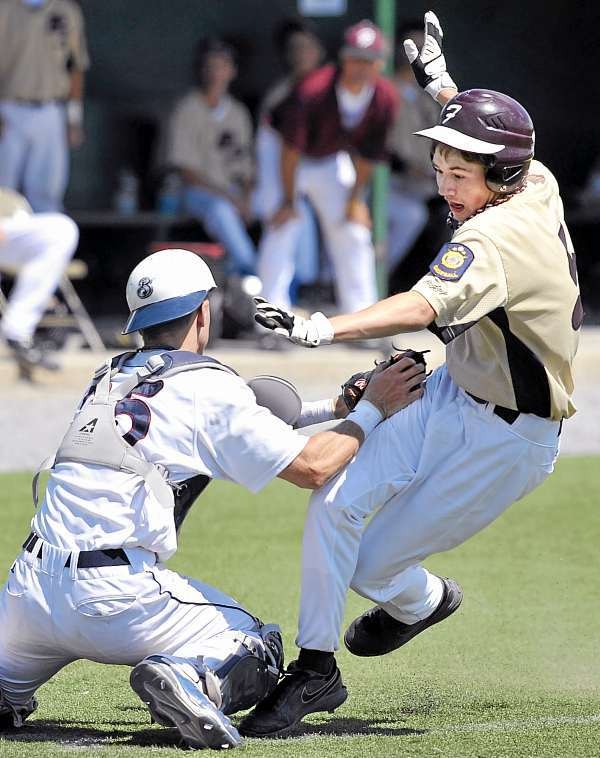 Brewer Falcon Cody Farrell, (5), can't get by the tag of Bangor Comrade catcher Dylan Morris for the out in the 7th inning of their game Sunday, July 18, 2010. Bangor Daily News/Michael C. York