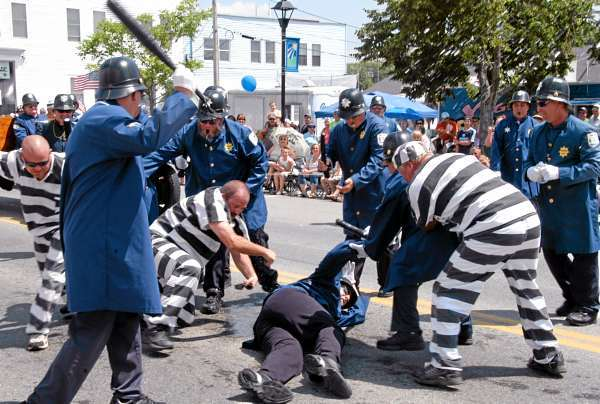 PARADE4: A Keystone Cop gets ambushed by a prisoner during an unruly portion of the &quotJust Cartooning Around&quot 2010 Annual Homecoming Parade in Lincoln on Saturday. (Bangor Daily News/Nick Sambides Jr.)