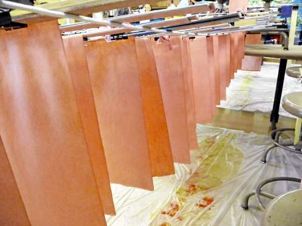 Sheets of hand-dyed paper dry during a class at the Paper and Book Intensive at the University of Maine at Machias.  Buy Photo
