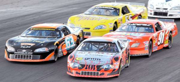 Eddie MacDonald, front right, leads the pack during a late restart during Sunday night's race.