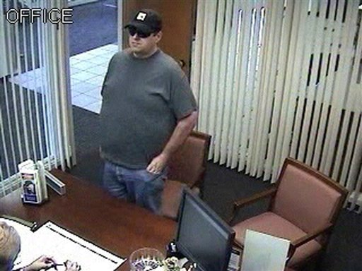 This Tuesday, July 13, 2010 security camera photo released by the Orono, Maine police shows Robert Ferguson, of Lowell, Mass., at Bangor Savings Bank in Orono.  Ferguson, a Greyhound bus driver, was arrested at a Bangor motel early Wednesday, July 14 after police received a tip from a motel employee. (AP Photo/Orono Police Dept. via Bangor Daily News) NO SALES; MAGS OUT; MANDATORY CREDIT