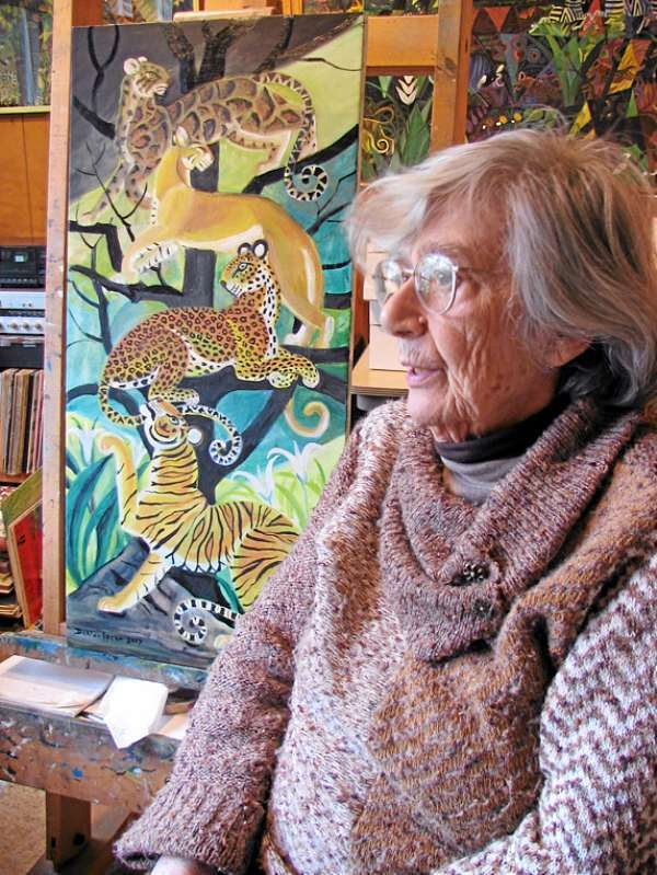 The painter Dahlov Ipcar sits among some of her paintings in her Georgetown studio. (BANGOR DAILY NEWS PHOTO BY KRISTEN ANDRESEN)