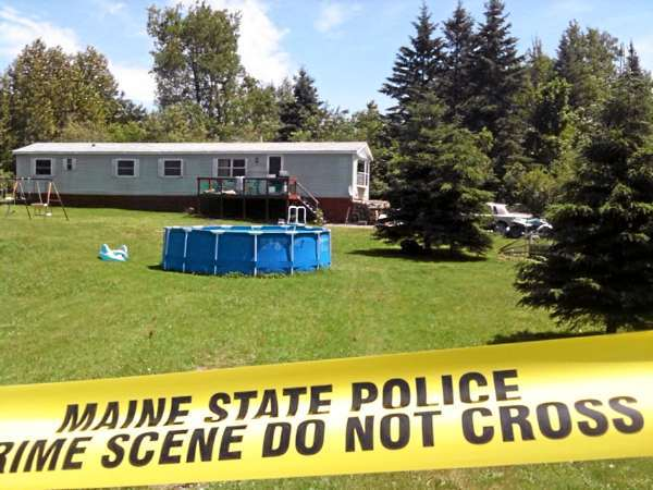 (BANGOR DAILY NEWS PHOTO BY JOHN CLARKE RUSS)  CAPTION  Maine State Police detectives are back on the scene Friday morning investigating the triple homocides in Amity.  (Bangor Daily News/John Clarke Russ)