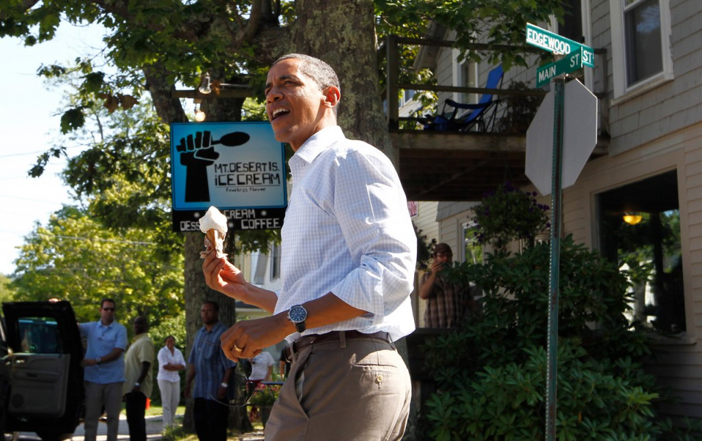 President Barack Obama holds a coconut ice cream cone after a visit to Mount Desert Island Ice Cream in Bar Harbor, Maine, Friday, July 16, 2010. (AP Photo/Charles Dharapak)