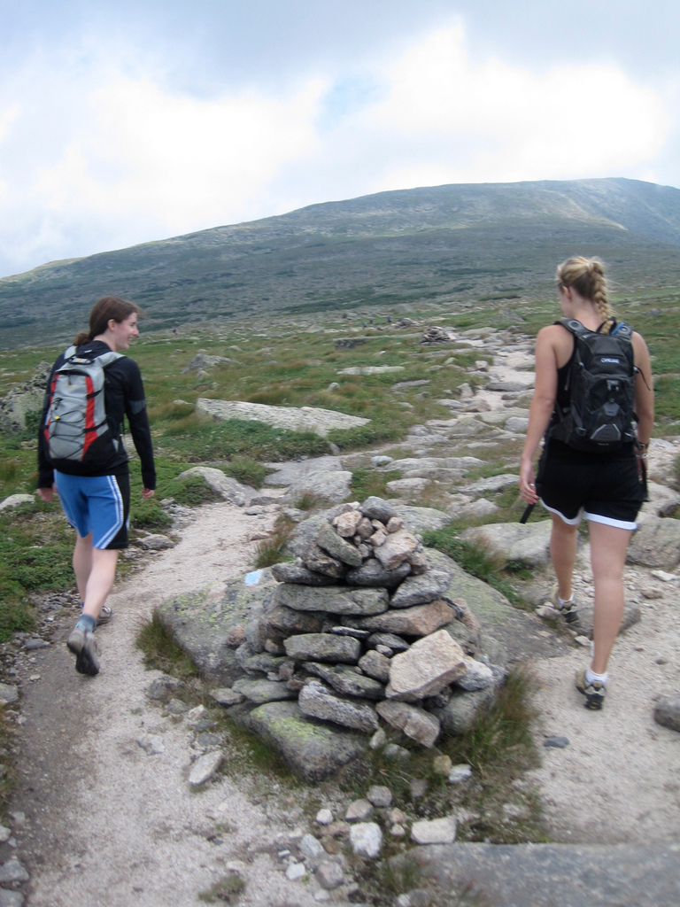Eve Jordan, 20, left, and Aislinn Sarnacki, 22, hiking around a cairn on the Tablelands of Mount Katahdin. Photo courtesy of Derek Runnells