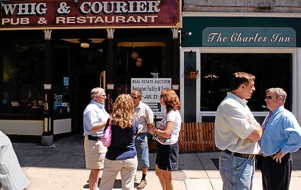 Attendees gather outside the Whig & Courier Pub & Restaurant following Wednesday morning's auction of the restaurant facility and equipment. (Bangor Daily News/John Clarke Russ)