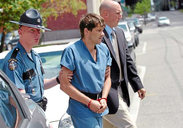 Dennis Edgecomb, 39, of Morrill is escorted from Waldo County Superior Court on Wednesday, July 21, 2010 following his first appearance for the murder of Pamela Green, 42. (Bangor Daily News/Bridget Brown)