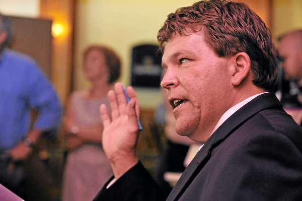 Stefan Keenan (cq), real estate division manager with South Portland-based Keenan Auction Company,  suggests a bid during the auctioning of Whig & Courier's restaurant facility and equipment Wednesday morning, July 21, 2010. The highest bid was $355,000. (Bangor Daily News/John Clarke Russ)