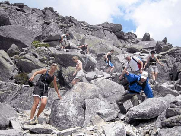 A group of friends and family hiking down Abol Trail, Mount Katahdin. (From top to bottom) Jeff McBurnie, Janet Jordan, Eve Jordan, Kerry Jordan (far right), Bruce Jordan, Joyce Sarnacki, Aislinn Sarnacki (far left), and Gary Robinson. Photo courtesy of Derek Runnells