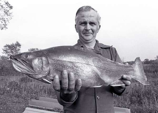 James &quotBob&quot Foster Sr. of Howland poses with the 8-pound, 8-ounce brook trout that he caught in Aroostook County's Chase Pond back in 1979. The trout held the state record for more than 30 years before that record was recently broken. The other anglers in Foster's party that day also had good luck, landing three fish that ranged from 4 1/2 to more than eight pounds. Photo taken Oct. 2, 1979. (Bangor Daily News file shot/Scott Haskell)  WITH HOLYOKE STORY