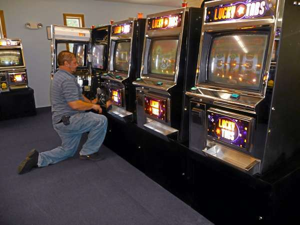 Technicians put the final touches on machines Friday at the Passamaquoddy reservation's bingo parlor.  More than 200 people were expected to attend the inaugural games when thedoors to the Indian Township facility open at 8 a.m. oday. The first game will start at 10 a.m and regular games will begin at noon. The  winning pot could be larger than $4,000, Passamaquoddy Tribal Governor William Nicholas said Friday morning. &quotWe're ready,&quot he said.  BANGOR DAILY NEWS PHOTO BY SHARON KILEY MACK