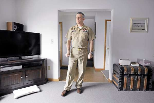 In this photo taken March 3, 2010, Chief naval air crew operator Steve Knipe stands in his military housing at Brunswick Naval Air Station in Brunswick, Maine. Knipe, who lives on the base with his wife and son, has served at Brunswick since 1989. The base is scheduled to close in the upcoming months. (AP Photo/Robert F. Bukaty)