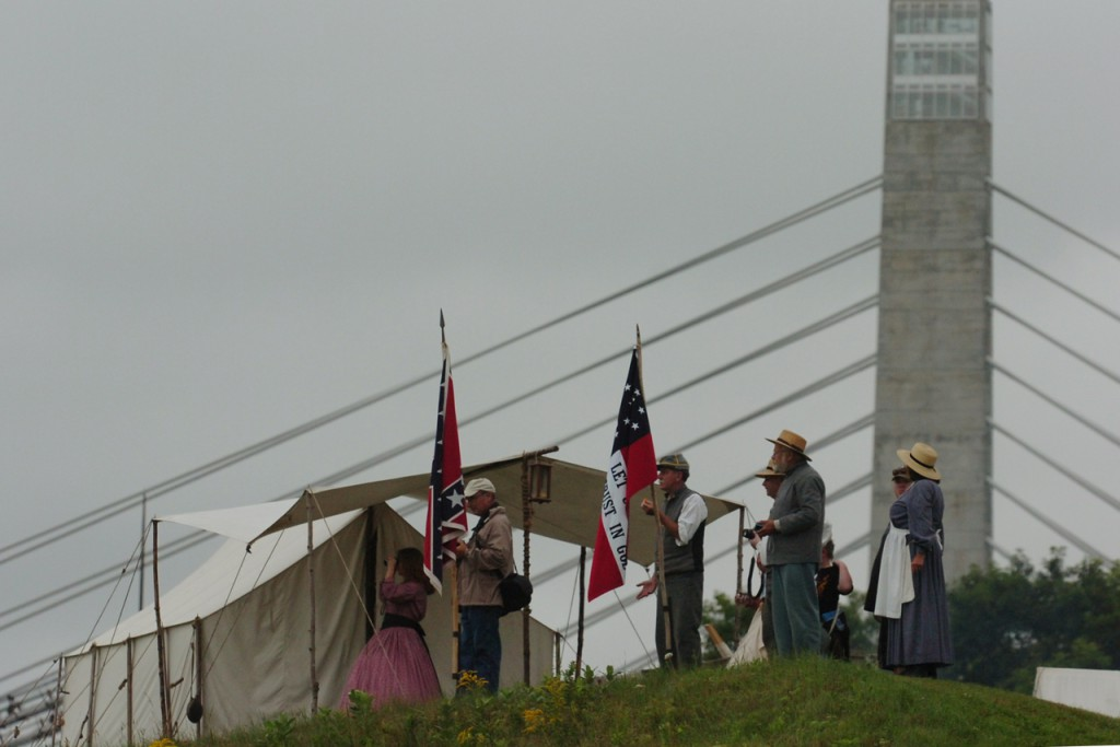 Spectators and reenactors  look out over the Penobscot River as the schooner Bowdoin sails up the river during the Battle at Fort Knox in Prospect on Saturday, July 24, 2010.