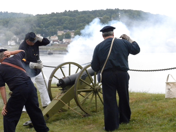Members of the 6th Maine Battery fire off a cannon Saturday during The Battle of Fort Knox over the weekend in Prospect. Buy Photo