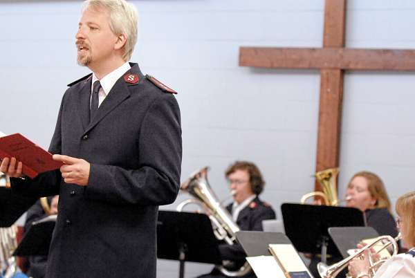 Newly-installed Captain Timothy Clark (left) sings to the music of the Salvation Army Corps brass band which includes his wife Evelyn (center) playing baritone at the Salvation Army in Bangor on Sunday, July 25, 2010. (Bangor Daily News/Bridget Brown)