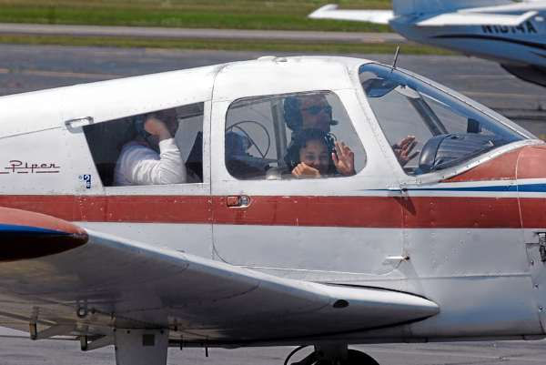 At the conclusion of an Angel Flight , pilot Dan Herrick taxis his single-engine plane into a spot on the General Aviation ramp at Bangor International Airport with Camara Johnson, 11, of  Woodland, and her mother, Cherie Nichols, who were brought to Bangor for a medical appointment for the girl.(Bangor Daily News/Scott Haskell)