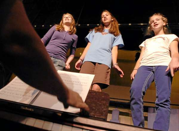 (L to R) Jaime Roy, Rachel Benway and Greta Frost rehearse their part in the 1920's jazz-age musical,Thoroughly Modern Mille, at the Penobscot Theatre in Bangor on Monday, July 26, 2010. (Bangor Daily News/Kevin Bennett)