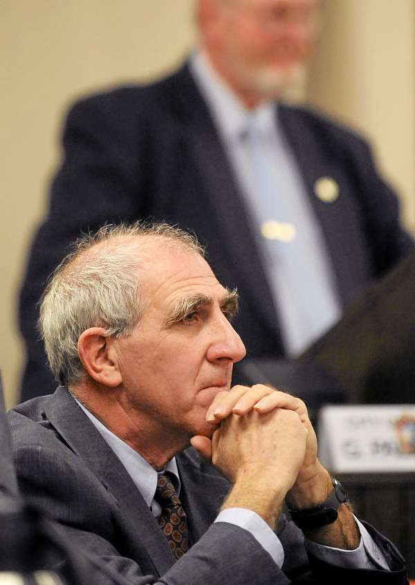 Richard Stone (foreground) was voted by the Bangor City Council to be its new chairman. Stone replaces Gerry Palmer, who served a year in that position.  (BANGOR DAILY NEWS PHOTO BY GABOR DEGRE)  CAPTION  Richard Stone (foreground) was voted by the Bangor City Council as the new chairman of the council.  Stone is replacing Gerry Palmer (background) after he served a year in the position. (Bangor Daily News/Gabor Degre)