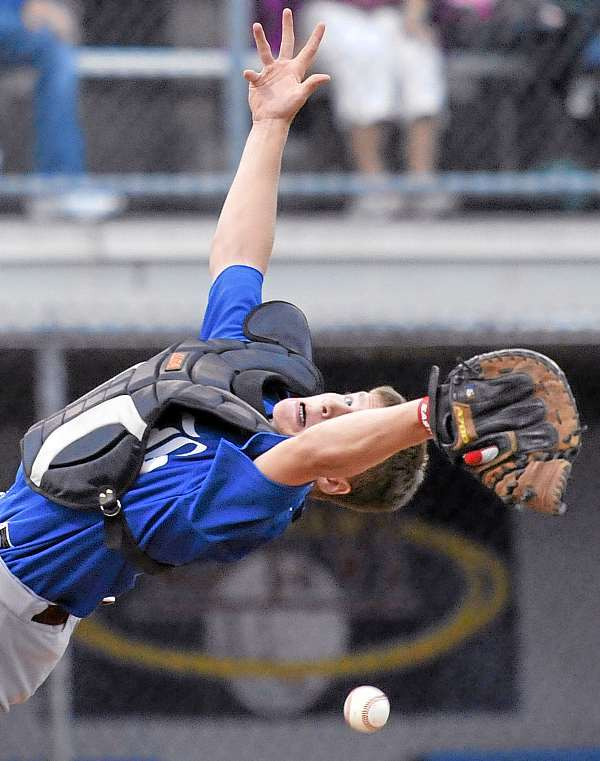 Bangor catcher Dylan Morris makes a diving stab for a pop-up on the infield in the home half of the first inning of their allstar game versus Brewer, MOnday, July 26, 2010. Bangor Daily News/Michael C. York