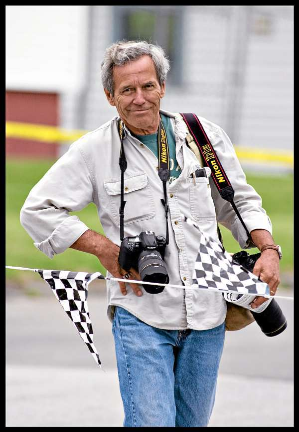 Bangor Daily News photographer Bob Delong poses for a photo at the sidelines of the 2004 soap box derby in Brewer. Delong died on Friday after a short illness.(Photo courtesy of Monty Rand)