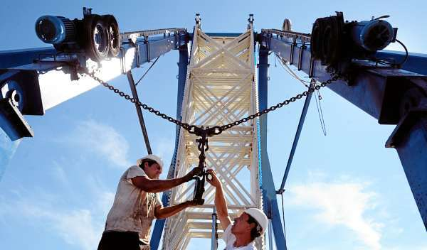 Cliff Phol (left) and Paul Fay work on setting up the Ferris wheel in Bass Park Tuesday, July 27, 2010 in preparation for the upcoming Bangor State Fair.  The 161st edition of the fair opens Friday afternoon, July 30, running through Sunday, August 8.  (Bangor Daily News/Gabor Degre)