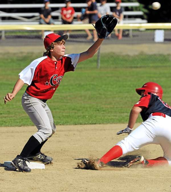 Camden-Rockport's Kienan Brown misses the throw as Bangor East's Ben Crichton slides safely into second base during 4th inning action in Hampden on Tuesday, July 27, 2010. (Bangor Daily News/Kevin Bennett)
