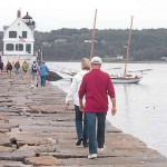 Brave souls walk the Rockland Breakwater in December