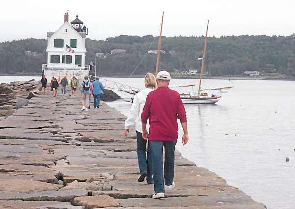 Lighthouse lovers walked the mile-long Rockland Breakwater on Sept. 12 to tour the famous lighthouse and keeper's quarters during the inaugural Maine Open Lighthouse Day sponsored by the U.S. Cost Gaurd. maine Office of Tourism and American Lighthouse Foundation. Twenty-nine lighthouses from one end of the coast to the other were open to the public during the event.