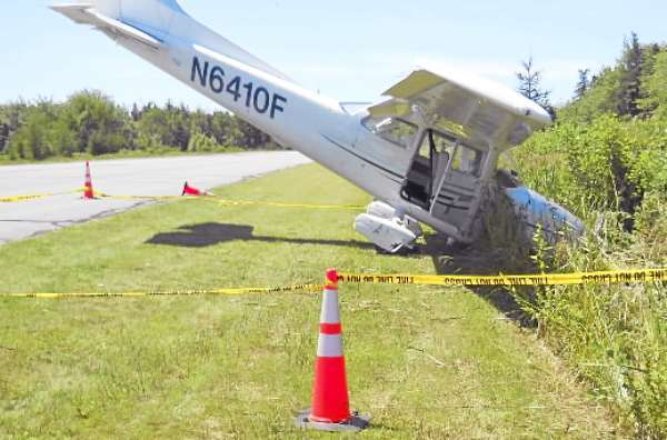 Hewitt story: SLUG: AIRCRASH Two people escaped injury Tuesday, July 27, 2010 when their single-engine plane crashed while landing at the Stonington Airport.  PHOTO COURTESY OF KATHLEEN BILLINGS-PEZARIS