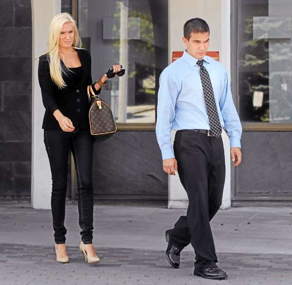 Derek Stansberry  (right) leaves the Margaret Chase Smith Federal Building with his girlfriend Jillian Krause in Bangor on Wednesday, July 28, 2010. BANGOR DAILY NEWS PHOTO BY GABOR DEGRE