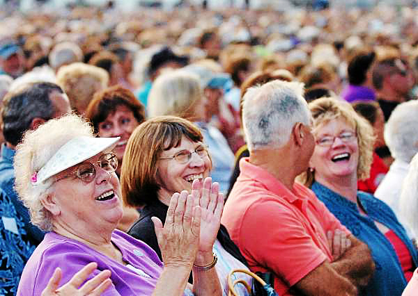 Beverly Beckwith of Durham (left) and Sylvia Pickard of Sabattus enjoy Celtic Woman's performance on the Bangor Waterfront on Wednesday, July 28, 2010 as part of the Hollywood Slots Waterfront Concert Series. (Bangor Daily News/Bridget Brown)