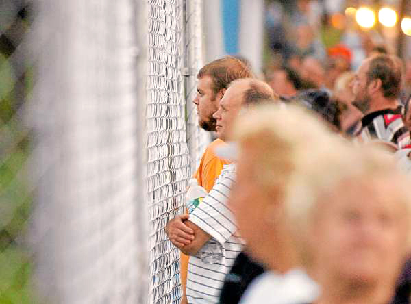 Spectators line Main Street to watch through a fence as Celtic Woman performs on the Bangor Waterfront on Wednesday, July 28, 2010 as part of the Hollywood Slots Waterfront Concert Series. (Bangor Daily News/Bridget Brown)