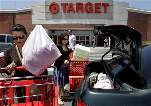FILE - In this file photograph taken June 2, 2010, shoppers Joselin Pena, left, and her niece Ingrid Romero, center, both of Boston, load packages into their car after shopping at a Target location, in Boston. A monthly consumer survey shows that Americans' confidence in the economy eroded further in July amid job worries. The reading raises concern about the economic recovery and the back-to-school shopping season.(AP Photo/Steven Senne, file)