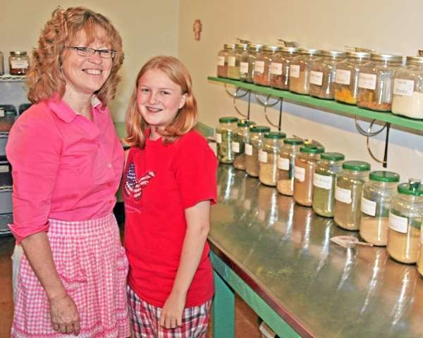 CHERYLE MATOWITZ, left, director of Bread of Life, a bulk food and specialty store located at 769 Main St. in Presque Isle, and her 14-year-old daughter, Natalie, stand next to some of the spices and herbs that are sold at the store. Matowitz said the business is somewhat like a natural foods store; however, she features a lot of specialty items ?that you can?t get somewhere else.? Bread of Life features everything from beans, wheat, flour, rolled oats, fruits, cheeses, desserts, sodas and much, much more. Staff photo/Scott Mitchell Johnson