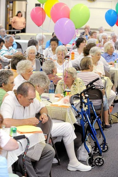 A group of mostly seniors listen to the speakers during the birthday party  held to commemorate the 45th anniversary of the creation of Medicare and Medicaid.  A number of health care agencies hosted the event that was held at the First United Methodist Church in Bangor Thursday, July 29, 2010. (Bangor Daily News/Gabor Degre)