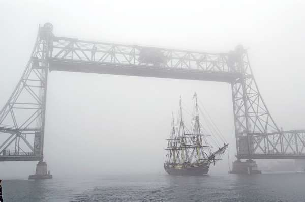 FILE - In this Aug. 2004 file photo, the Friendship of Salem sails under the Memorial Bridge in a dense fog in Portsmouth, N.H.  An independent study of options for replacing bridges between Maine and New Hampshire is due by month's end. Earlier this week, a giant piece of the Memorial Bridge fell into the water, nearly hitting a boat passing underneath.(AP Photo/Portsmouth Herald, Rich Beauchesne, files)