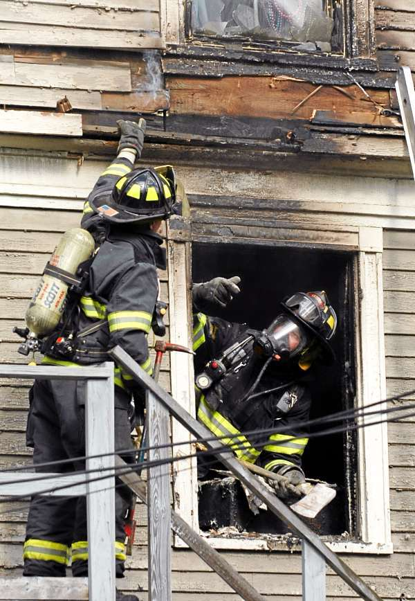 Bangor firefighters put out a small apartment fire at 151 Essex Street in Bangor in the late afternoon, Friday, July 30, 2010. (Bangor Daily News/Kevin Bennett)