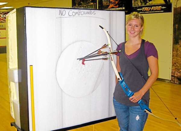 Goes with outdoor story &quotTradarchery&quot Aislinn Sarnacki stands in front of a target at Old Town Archery Center & Pro-Shop in Old Town. The target records her final shots in a one-on-one archery lesson at the shop on Wednesday.  (Photo courtesy of Old Town Archery Center & Pro-Shop )