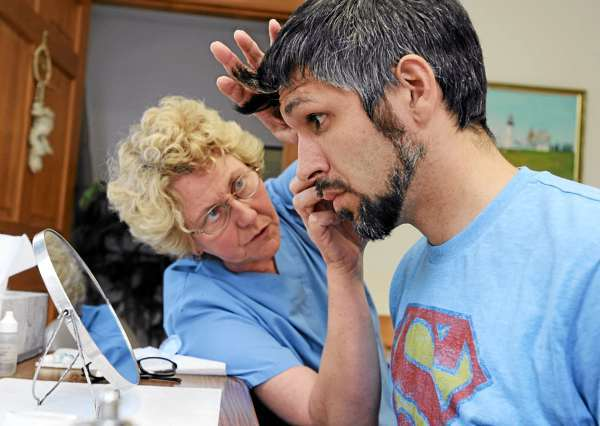 Adam Jewell, right, of LaGrange, gets fitted with a prosthetic eye by Ocularist Ottie Thomas-Smith at her office in Jackson on Friday, July 30, 2010. Jewell lost his eye in May when a friend accidently shot him while turkey hunting in the town of Chester.  BANGOR DAILY NEWS PHOTO BY KEVIN BENNETT