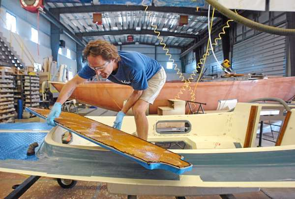 Kirk Ryder works on the deck of a M29 Daysailer at Morris Yachts in Trenton on Friday, July 30, 2010. Morris Yachts is one of many boatyards which will be open to the public Aug. 16-17 for Open Boatyard Days. BANGOR DAILY NEWS PHOTO BY BRIDGET BROWN