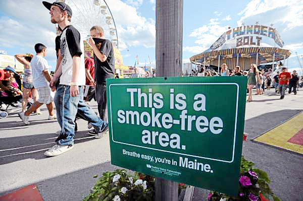 A sign at the entrance to the midway of the Bangor State fair reminds visitors that the fairgrounds are a no smoking area. Designated areas under canopies are available to those that need to smoke.  BANGOR DAILY NEWS PHOTO BY KEVIN BENNETT