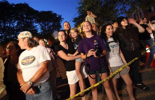 People gather outside the Beekman Arms Inn to catch a glimpse of guests arriving for a party in honor of Chelsea Clinton and Marc Mezvinsky Friday, July 30, 2010 in Rhinebeck, N.Y.  (AP Photo/Mary Altaffer)